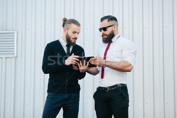 Iki işadamları bir şey bakıyor iş Stok fotoğraf © tekso