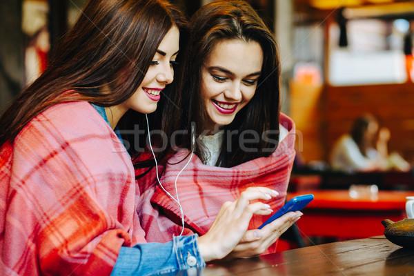 Two girl listening music Stock photo © tekso