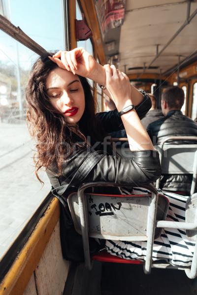 Femme à l'intérieur tram ensoleillée Photo stock © tekso