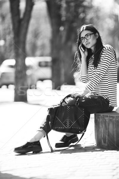 Güzel kız poz kamera şehir telefon kadın Stok fotoğraf © tekso