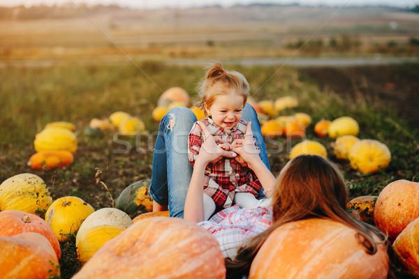 Mãe filha mentir abóboras campo halloween Foto stock © tekso