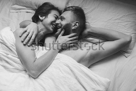 Young couple in bed together Stock photo © tekso