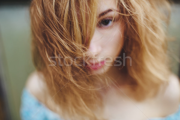Portrait of a beautiful red-haired girl Stock photo © tekso