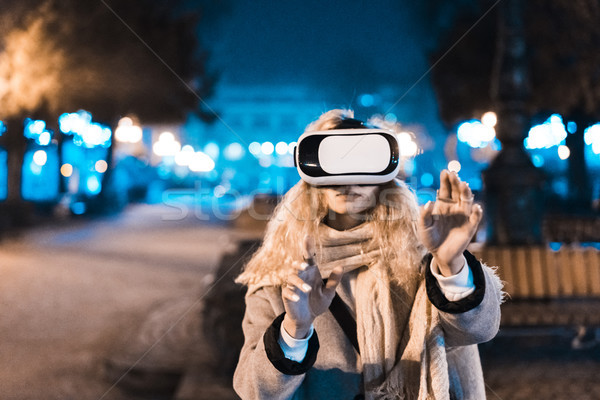 Young girl getting experience VR headset Stock photo © tekso