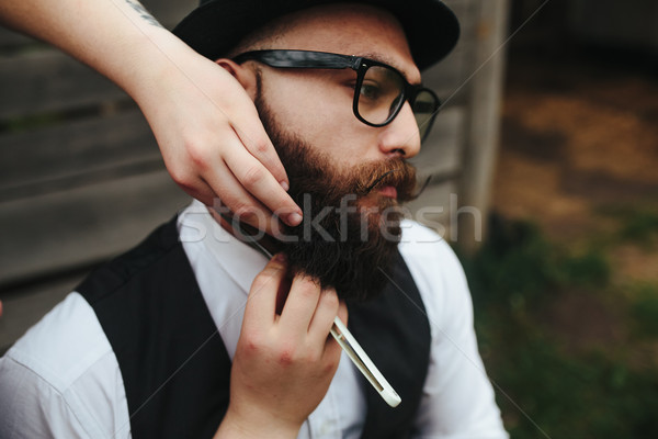 barber shaves a bearded man Stock photo © tekso