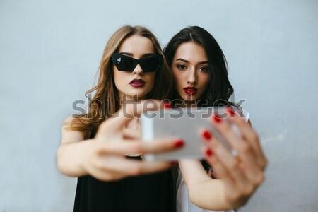 Two girlfriends taking a selfie Stock photo © tekso