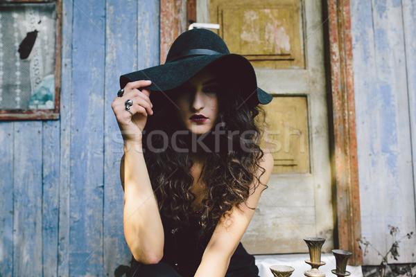 Klasszikus nő boszorkány pózol háttér elhagyatott Stock fotó © tekso