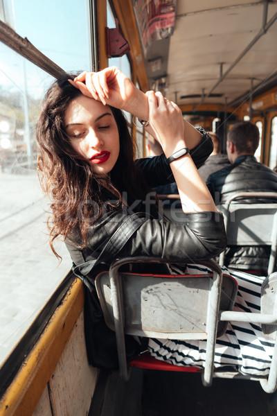 Kobieta wewnątrz tramwaj słoneczny Zdjęcia stock © tekso