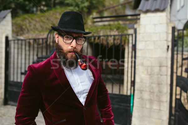 Bogate człowiek broda myślenia działalności kurtka Zdjęcia stock © tekso