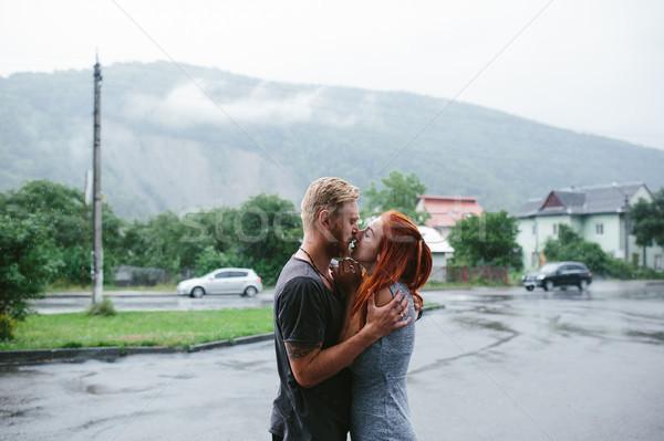beautiful couple hugging in the rain Stock photo © tekso