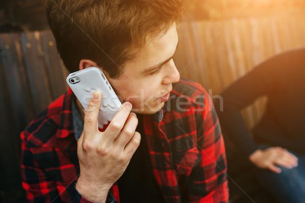 man talking on smartphone Stock photo © tekso