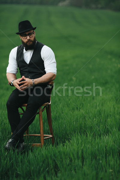 man with a beard, thinking in the field Stock photo © tekso