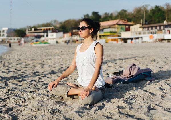 Young woman practicing yoga Stock photo © tekso