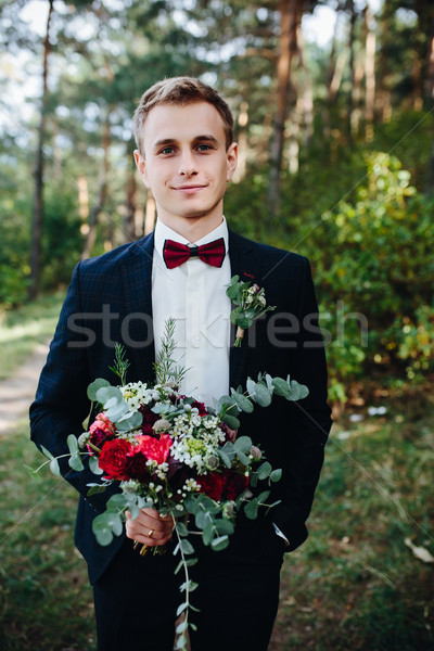Stock photo: groom holds bouquet