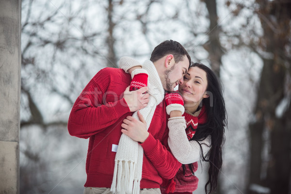 man and woman hugging in snow-covered park Stock photo © tekso