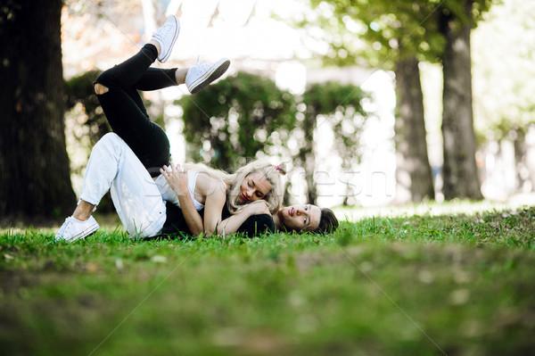 Casal grama homem mulher mentir Foto stock © tekso