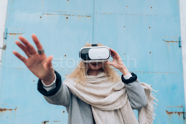 Girl in the street with a vr glasses Stock photo © tekso