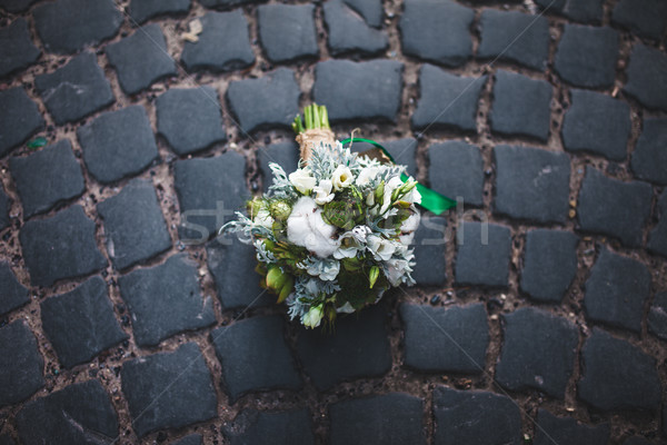wedding bouquet on the paving stones Stock photo © tekso