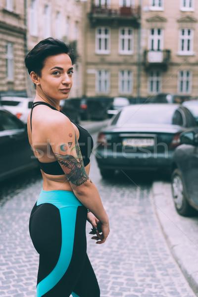 Nő testmozgás figyelmeztetés fitnessz sport sportruha Stock fotó © tekso