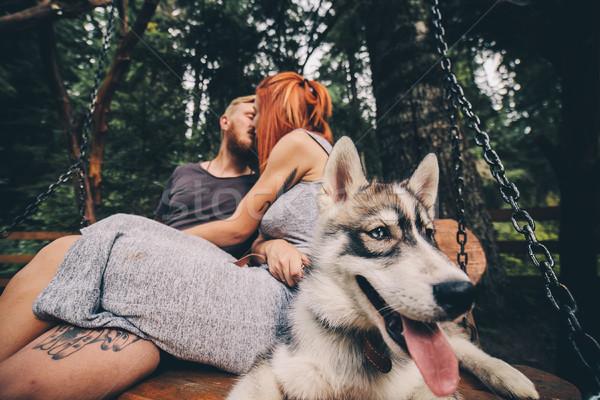 Piękna para wraz psa huśtawka Zdjęcia stock © tekso