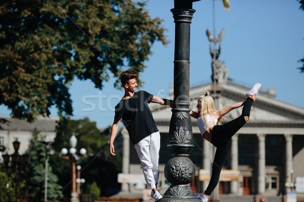 man and woman performing acrobatic tricks Stock photo © tekso