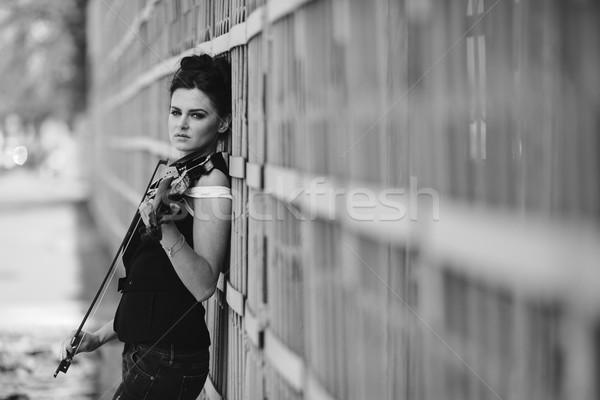 girl posing with violin Stock photo © tekso