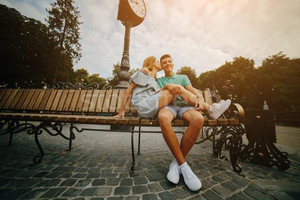 парень девушки сидят скамейке человека женщину Сток-фото © tekso