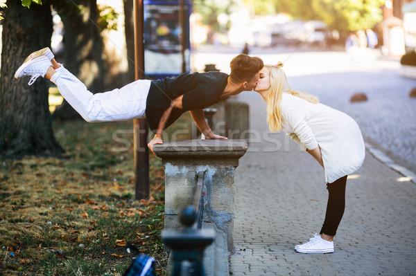 Adam akrobatik hile kız park kadın Stok fotoğraf © tekso