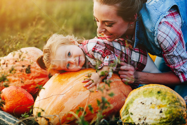 daughter lying on a pumpkin Stock photo © tekso