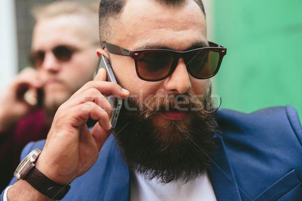 Dos barbado empresario mirando teléfono empresarios Foto stock © tekso