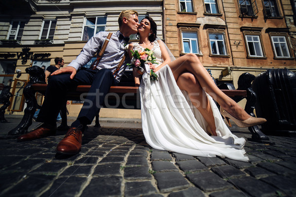 bride and groom sit on the bench Stock photo © tekso