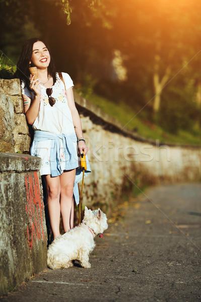 Lány fagylalt kutya fal út boldog Stock fotó © tekso