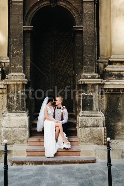 Bride sitting on lap of the bride Stock photo © tekso
