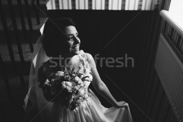 Bride posing on the chamber Stock photo © tekso