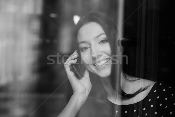 Beautiful girl sms telefone smiles negócio computador Foto stock © tekso