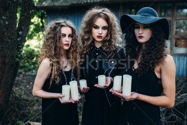 Stock photo: three vintage women as witches