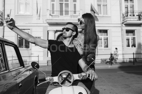 Cute couple make selfie on a scooter Stock photo © tekso