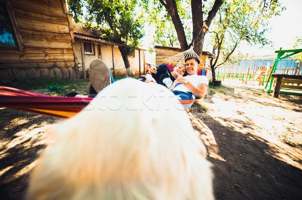 Ehemann ruhend Hängematte Land Lächeln Stock foto © tekso