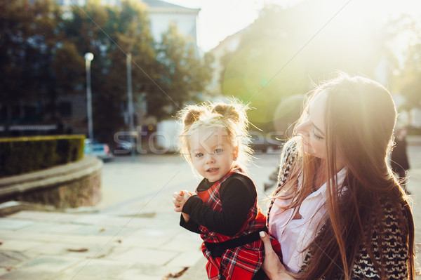 Mother and little daughter playing in a park Stock photo © tekso