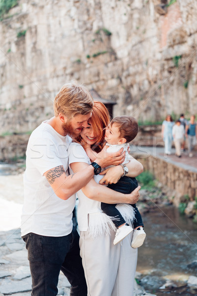 Stock photo: The family standing near a rock wall