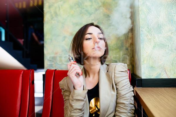 Fille électronique cigarette mystérieux jeune fille affaires Photo stock © tekso