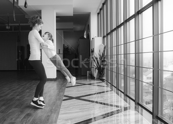 Mother twist her daughter in the gym Stock photo © tekso