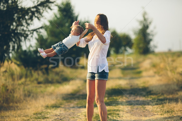 mother and daughter on a rural road Stock photo © tekso