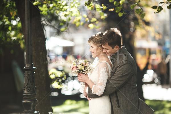 Groom hugs bride Stock photo © tekso