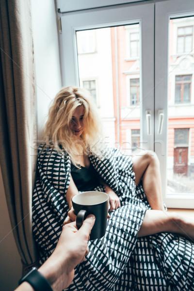 Fille séance fenêtre couverture boire Photo stock © tekso