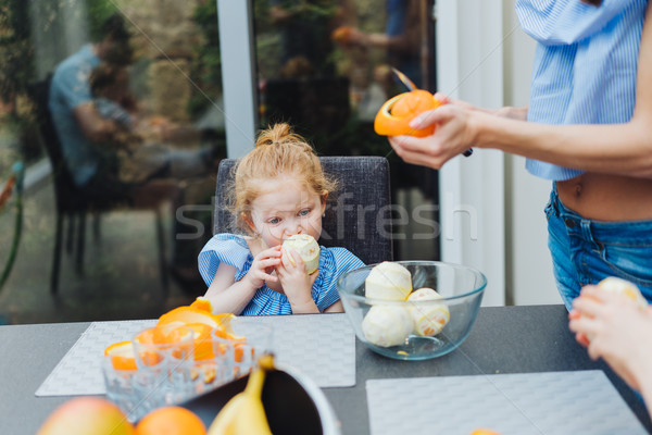Stock photo: Mom and daughter in the kitchen