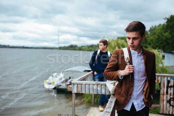 Dois jovem caras em pé pier pequeno Foto stock © tekso