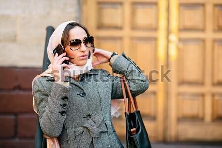Lány kabát utca gyönyörű lány sms instagram Stock fotó © tekso