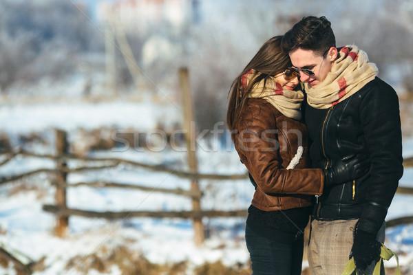Happy couple in snow park Stock photo © tekso