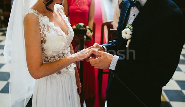 Putting the wedding ring on Stock photo © tekso
